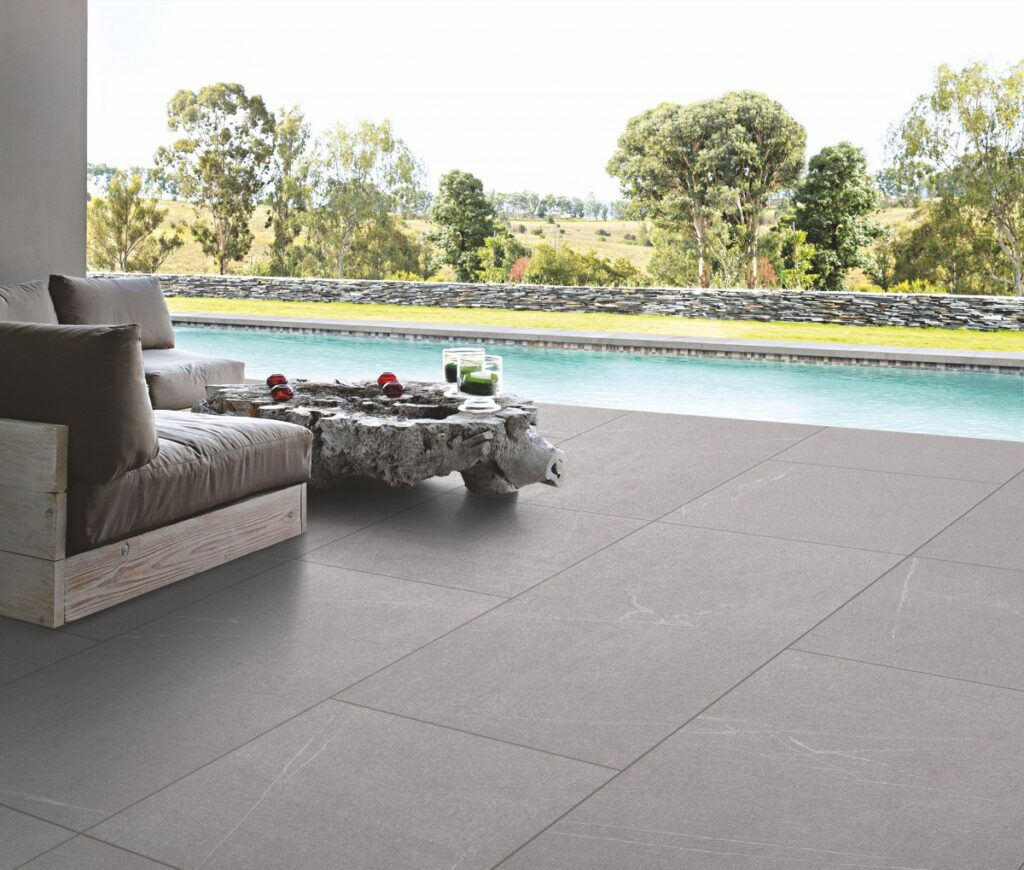 pool side area and natural stone tiles for flooring