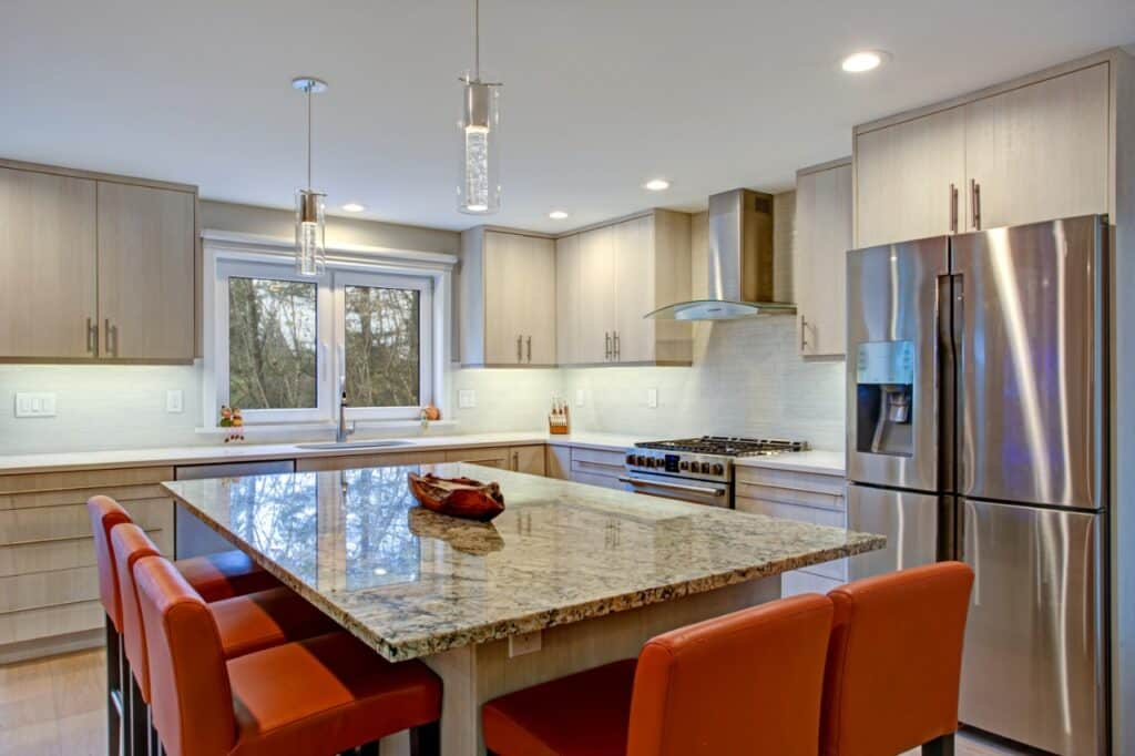 a kitchen island made of granite in the kitchen