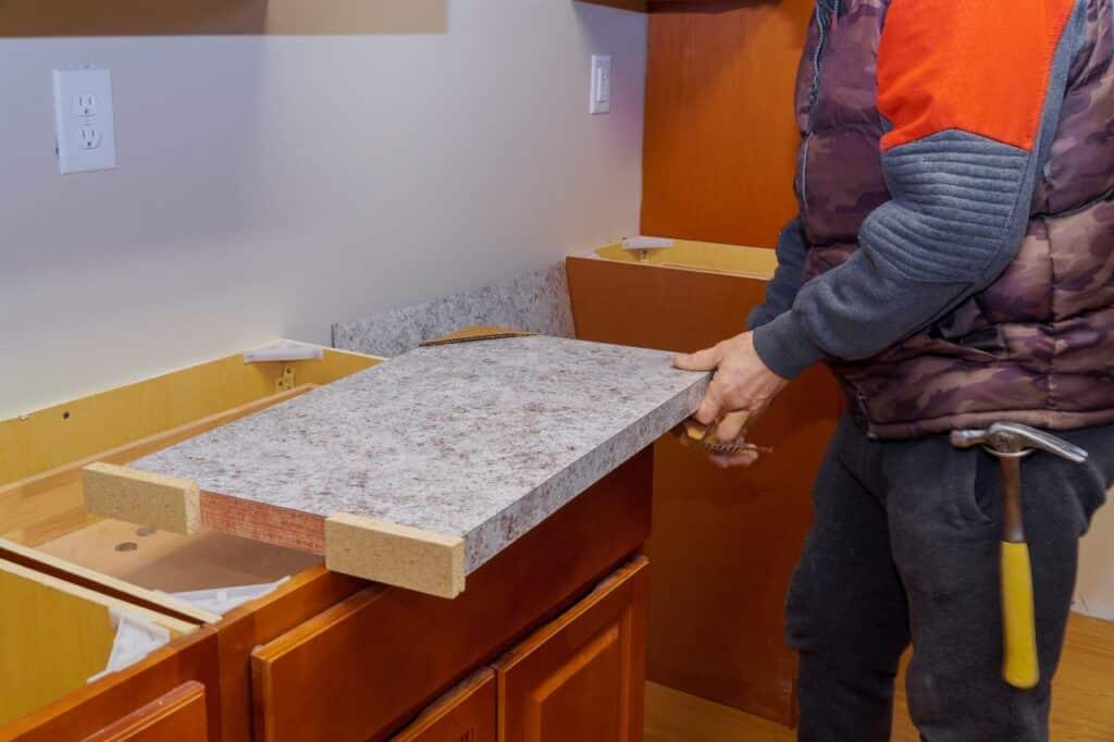 laminate countertop being installed