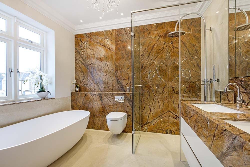 Bathroom with brownish marble wall.